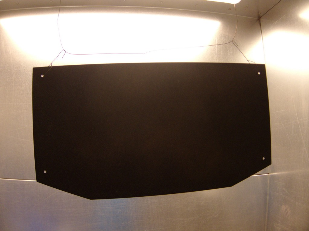 Powder coating the plate